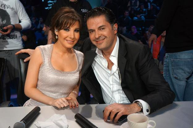 راغب علامة ونانسي عجرم خلال استراحة حلقة نتائج  Arab Idol
